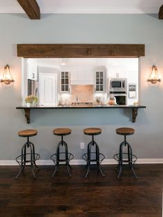 A section of wall between the kitchen and living room was removed to create this pass-through with serving bar.