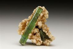 Bottle green Elbaite measuring to 3.8cm from Brazil. Crystal Classics Minerals