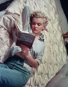 """Monroe, still reading. """"She  was awkward. She couldn't get  out of her own way. She wasn't  disciplined, and she was often late…""""  -Barbara Stanwych (Costar,  """"Clash by Night,"""" 1952)  Photo by John Florea, 1951 (Reproduced with permission of Melanie and Gwen Florea)."""