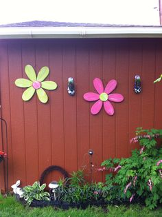 Wooden Flowers with flip flop planters very cute...maybe wooden spoons cut off for the petals would make it easy=D