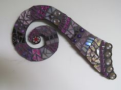Mosaic Koru in Purple tones