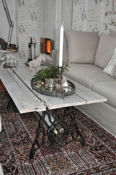 Table made of old barn door and an old iron sewing machine table http://sekelskiftesdrom.blogspot.se
