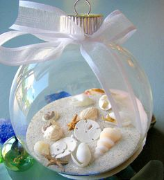 "Genius! Gather sand/rocks/colorful dirt from every beach visit & vacation and put it in a glass ornament as a great tradition. Another ornament for the ""nautical"" Christmas tree. #diy #beach #nautical #ocean #vacation #memories #ornament #christmas #shells #sand"