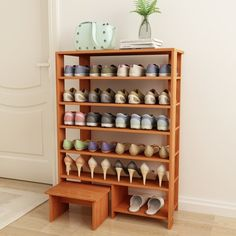 DL furniture Espresso Finish Solid Wood Storage Shoe Shelves Storage Rack with chair; even though it's from Wal-Mart I love the design. You could make a sturdier version of your own!