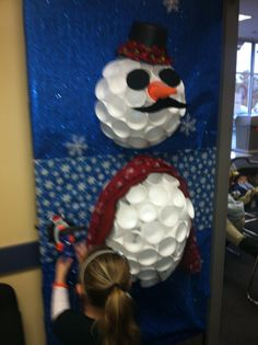Snowman door decoration out of styrofoam cups