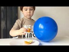 How To Pop Balloons With An Orange Peel - YouTube
