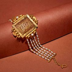 The Lalitha Gold Bracelet and The Shruti Gold Earrings is a finest pick when it comes to displaying rich culture and heritage Visit the… Indian Jewelry Earrings, Real Gold Jewelry, Hand Jewelry, Gold Jewellery Design, Gold Earrings, India Jewelry, Jewelry Rings, Drop Earrings, Armband Rosegold