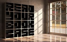 Read Your Book Case. A Modular Typographical Bookcase by Saporiti. Definitely easier to see the words when it is empty.