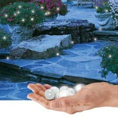 Fairy Berries Lights, charming little orbs of light gently fade in and out to add some after-dark magic to any yard; scatter or hang them anywhere--they're even water resistant to add a glow to your pool, fountain or pond Diy Garden, Dream Garden, Garden Art, Garden Landscaping, Home And Garden, Garden Ideas, Fairy Berries, Fairy Houses, Outdoor Projects