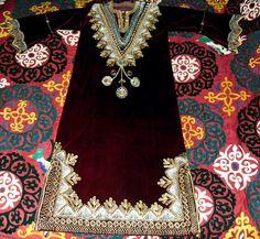 Vintage Moroccan Embroidered Full Length Kaftan Gold and Silver on Burgundy Velvet. $138.00, via Etsy.