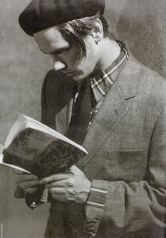 """River Phoenix reading Leo Tolstoy's """"War And Peace"""" Photograph by Bruce Weber, 1991."""