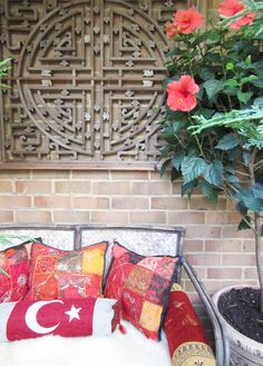 #balcony pillows and chinese window screen