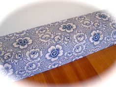 This blue and white COVER for a draft stopper would look awesome in a blue and white kitchen area. Revamp your door snake this winter. www.createdbycath.com