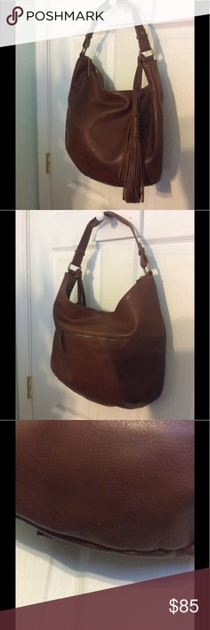 Lucky 🍀 Brand leather handbag.  Brownish color. EUC basically like new.  No dust bag.  I think it might be missing a four leaf clover hang charm - but it was missing from the bag when I purchased it.  No smoking or other odors.  It is kind of a reddish brown color.  Just as shown in pics.  Any questions please ask 😊 no PayPal please. Lucky Brand Bags Shoulder Bags