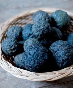 Woad balls. Woad is an old color. A conversation with history. A natural dye. #BLUE An ugly plant. Locked in green leaves, compounds that break into pigments of blue. Blues that can be as bold as a Blue Jay feather or as tender as an azure sky at dawn, as dark as ink or as milky as glacial ice.