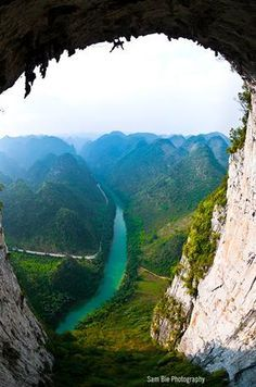 A perfect moment and stunning image Sam ble photography. Climber dangling from Great arch Getu China.