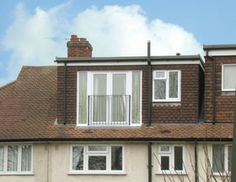 Dormer window with french doors and juliette balcony