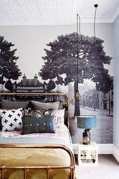 This wallpaper is an old photo of the street the house is located on. So clever!