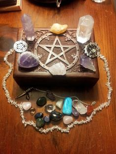 ".I like this ""altar in a box"" setup. Seems like the crystal beads should be used to make a circle, though."