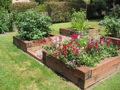 Raised garden beds – I like the thick railroad tie wood – easier for sitting to work around beds and definitely sturdy! I also like the gravel between the beds! :) #tiestobed
