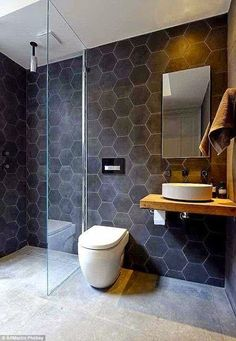Large grey floor tiles, hexagonal walls but white
