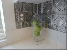 I can't decide if I like this tin back splash or not. You? I have seen chrome tile that I like.