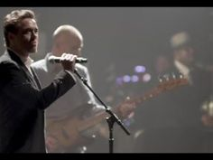 Robert Downey Jr sings with Sting and absolutely kills it.