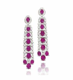 A PAIR OF RUBY AND DIAMOND EAR PENDANTS   Each tapering panel centred by a series of oval mixed-cut rubies to the millegrain-set brilliant and baguette-cut diamond pierced surround, with a triple ruby drop termination, 6.2cm long, post fittings
