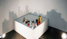 Artist Rashad Alakbarov uses light, shadows and found objects to create amazing city landscapes on walls.
