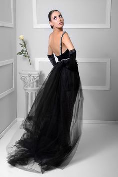 A black velvet gown with a hand made pearl skirt .  #mysterious #dress #jczakaria #couture