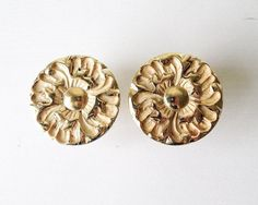 Vintage pair of fancy knobs--unlabeled. Metal with an golden-brassy finish. Looks like these were maybe salvaged from a mid century french provincial style furniture piece. Screws included. Listing is for a set of 2--chosen at random from my supply so may not be the exact ones shown in the pics. Only 1 set left available.  Condition: *Zoom pics* light tarnishing with some age spots to tops  Size approx: 1.5 in wide .75 in deep/stick out  **Please see Sadrosettas shop policies before…