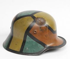 Camouflage - A print used in war as a way to increase the time it takes for eyes to focus on a target. There are a variety of different camouflages for various terrains; brownish yellow color was common in WW1. This is a German army issue steel helmet painted in a disruptive camouflage pattern. The French used Cubist artists to camouflage.