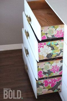 Add some color to your dresser with wallpaper.