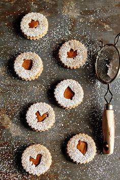 Pecan Linzer Cookies infused with pumpkin pie spice and sandwiched with Biscoff Spread. Thanksgiving Cookies, Holiday Cookies, Holiday Desserts, Linzer Cookies, Cake Cookies, Biscoff Cookies, Pumpkin Cookies, Fall Recipes, Sweet Recipes