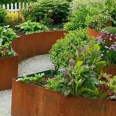 Love this idea!  Oxidized (and recycled) Cor-ten steel that looks more like sculpture than planters. Easy to work with and creates great, sexy curves. The 1/4-inch-thick metal absorbs the sun's heat, helping to warm the soil in cool weather.