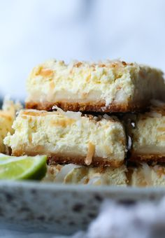 Coconut Lime Cheesecake Bars are creamy, tangy and DELICIOUS! The shortbread crust and the rich cream cheese pull everything together for the perfect potluck dessert!