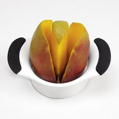 Shop OXO Mango Splitter at CHEFS.  No-mess pitting and slicing. This ingenious tool lets you remove mango seeds and cut fruit in half.