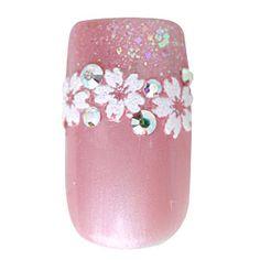 桜のネイルシールでフレンチ風に仕上げたデザイン。春の華やかな気持ちにぴったりです。