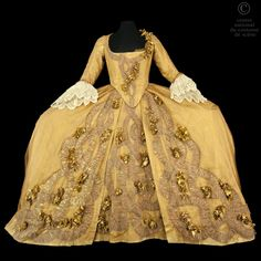 Opera National de Paris Eighteenth century style dress in brown silk tulle covered with gold. Garnish with flowers and tulle gold painted brown and red. Engaging in white lace. Long skirt covered with brown muslin. Petticoat very large baskets in white nylon.