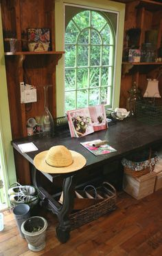 this antique table fits perfectly inside the adorable garden shed and provides a great work space