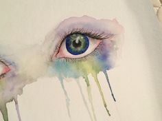 When making this painting of eyes, I started by sketching out the drawing in pencil on the watercolor paper. Once it was sketched, I went over it using watercolor paint. Around the eyes, I held the paper upwards to create a dripping effect with the paint.