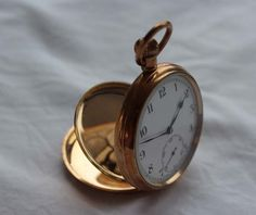 A 9ct gold keyless wound open faced pocket watch #watch