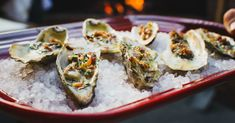 How to Grill Oysters in 2 Tasty Recipes (Video)  ||  Learn how to grill oysters with Toadfish Outfitters and Charleston's The Macintosh, who also shared two delicious recipes for compound butter, one of the best pairings for grilled oysters. https://www.themanual.com/food-and-drink/how-to-grill-oysters/