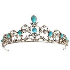 a Victorian convertible tiara / necklace made with turquoise and diamonds. Made of I8k gold and silver. another great beer drinkin', laundry foldin', house cleanin' tiara.......