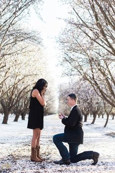 This snowy orchard proposal will have you teary-eyed.