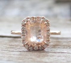 A dreamy peach sapphire makes for an unforgettable engagement ring.