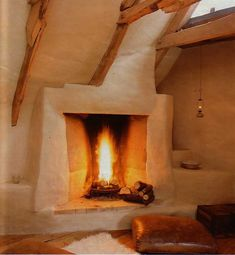 Interesting Cob house fireplace feature. The modified Rumford design could use some irregularity in the shape of the top of the rectangular opening and mantel areas. Outside of that, it feels like it could fit naturally in a canyon wall somewhere. And that's why I want to feature one like it in my home.