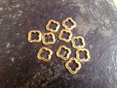 925 sterling silver quatrefoil connector 12mm with 24K vermeil with 2 holes    Quantity 10 pieces    Weight for 10 pieces approximately = 6.1 gram