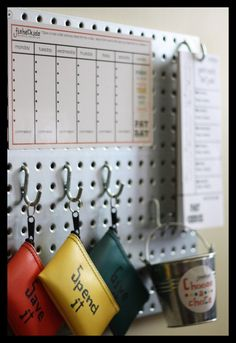 This is an all-in-one take on chore charts for kids. Everything you need is organized on one sleek metal pegboard: chore chart, paycheck tearpad, money bags, and chore sticks. So organized and best of all: totally engages your children! Chores For Kids, Activities For Kids, Chore Sticks, Family Chore Charts, Chore Board, Responsibility Chart, Household Chores, Looks Cool, Parenting Hacks