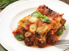 This lasagna Napoletana recipe is INSANE with meatballs, sausages, and four types of cheese. #recipe